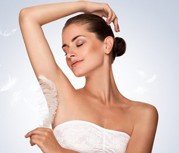 Young woman holding her arms up and showing clean underarms, depilation smooth clear skin